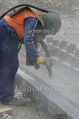 Tradesman Sandblasting I Beams For Building Project Stock Photo