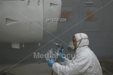 Tradesman Sprays The Engine On A Dornier 228 Aircraft Stock Photo