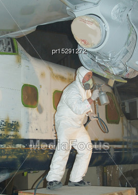 Tradesman Sprays The Primer Coat On The Engine On A Dornier 228 Aircraft Stock Photo