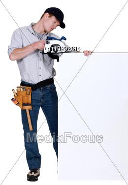 Tradesman Using A Circular Saw Stock Photo