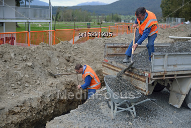 Tradesmen Fill In A New Stormwater Drain Stock Photo
