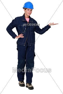 Tradeswoman Dressed In Denim Clothing Stock Photo