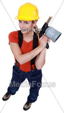 Tradeswoman Holding A Blowtorch Stock Photo