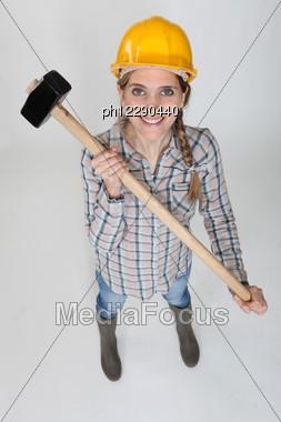 Tradeswoman Holding A Mallet Stock Photo