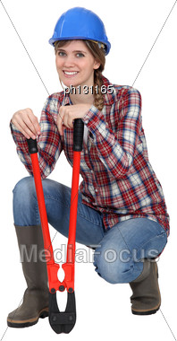 Tradeswoman Holding Pliers Stock Photo