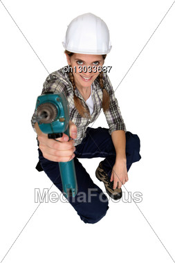 Tradeswoman Using A Power Tool Stock Photo