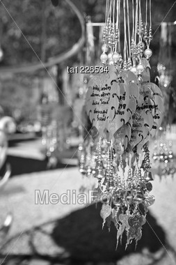 Traditional Buddhist Hanging Decorations With Bells And Handwriting Wishes, Prayer Words Stock Photo