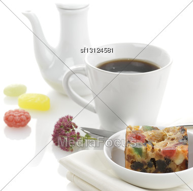 Traditional Christmas Fruit Cake With Cup Of Tea Or Coffee Stock Photo