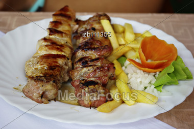 Traditional Greek Grill With Vegetables Served On White Plate Stock Photo