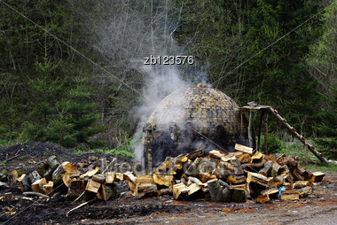 Traditional Smoky Charcoal Furnace Made Of Brick, At Mountain And In Forest. Stock Photo