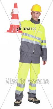Traffic Guard Holding A Pylon Stock Photo
