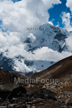 Trekking In Himalaya: Rocks And Mountains (pictured In Nepal Stock Photo