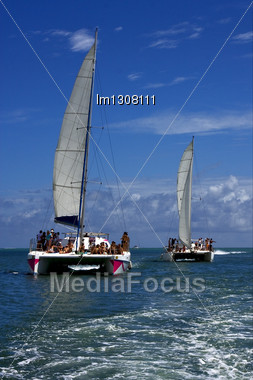 Tropical Lagoon Hill Navigable Froth Cloudy Catamaran And Coastline In Mauritius Stock Photo