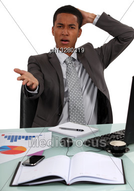 Troubled Businessman Remonstrating With The Audience Stock Photo
