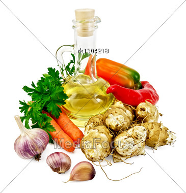 Tubers Of Jerusalem Artichoke, Garlic, Carrots, Parsley, Sweet And Spicy Red Pepper, A Bottle Of Vegetable Oil Stock Photo