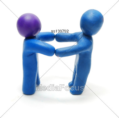 Two 3D Persons Of Plasticine Standing Holding Hands In Hands Stock Photo