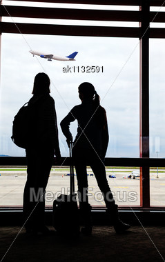Two Air Passengers Waiting For The Flight Stock Photo