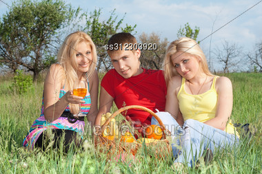 Two Attractive Blonde And Young Man Outdoors Stock Photo