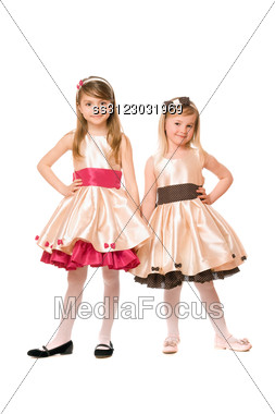 Two Beautiful Little Girls In A Dress. Stock Photo