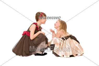 Two Beautiful Little Girls Talking. Stock Photo