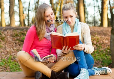 Two Beautiful Young Women Reading Patiently Their Books Stock Photo