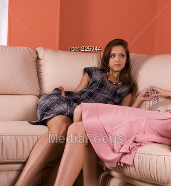 Two Beauty Women Closeup, Lying At Sofa Stock Photo