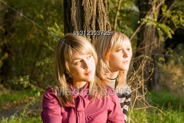 Two Beauty Young Blondes In The Light Of The Sunset Stock Photo