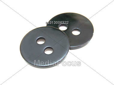 Two Black Buttons Lie Stock Photo