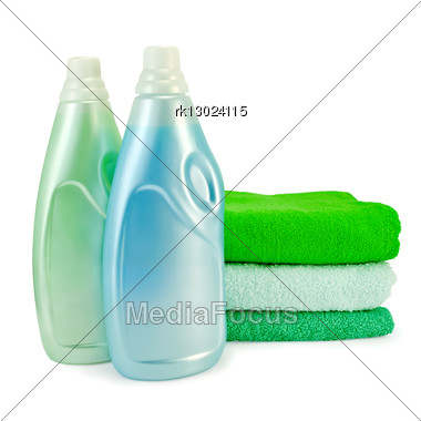 Two Bottles Of Fabric Softener Blue And Green Colors, A Stack Of Three Towel Stock Photo