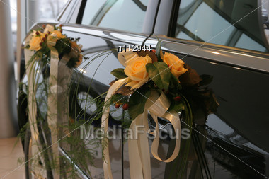 Two Bouquets Fixed To Car Doors Stock Photo
