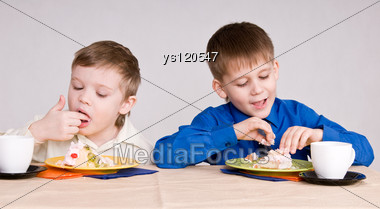 Two Boys Eating A Cake His Hands Stock Photo