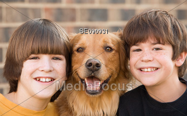 Two Boys with Their Dog Stock Photo