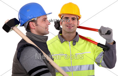 Two Builders With Tools Stock Photo