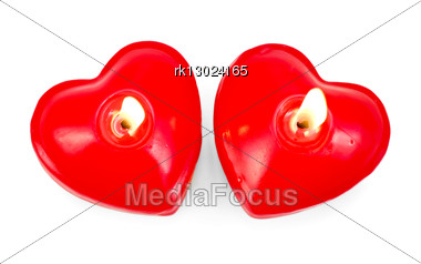 Two Burning Red Candles In The Shape Of A Heart Stock Photo