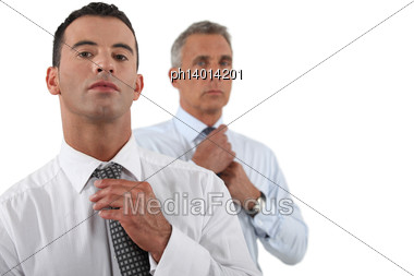 Two Businessmen Adjusting Ties Stock Photo