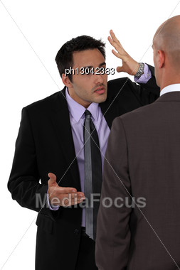 Two Businessmen Disagreeing Stock Photo