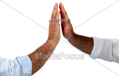 Two Businessmen Giving Each Other High Fives Stock Photo