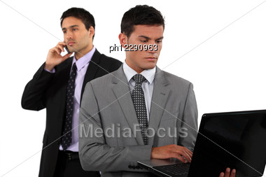 Two Businessmen In The Middle Of Closing A Deal Stock Photo