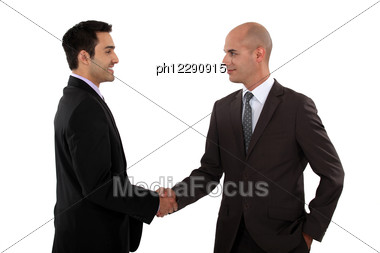 Two Businessmen Shaking Hands. Stock Photo