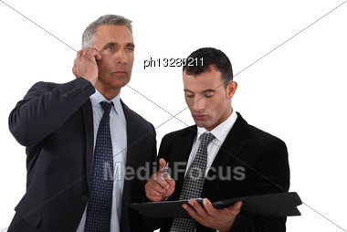 Two Businessmen Working Together Stock Photo
