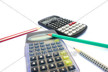 Two Calculators And Three Pencils Stock Photo