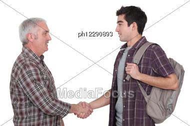 Two Casual Men Shaking Hands Stock Photo