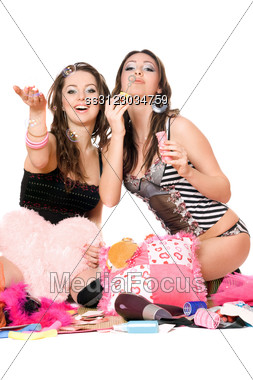 Two Cheerful Girls Blow Bubbles. Stock Photo