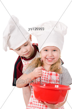 Two Children In Chef's Hat Stock Photo