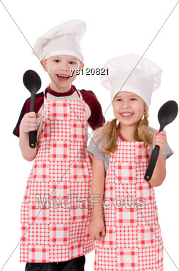 Two Children Chefs Holding Wooden Spoons Stock Photo