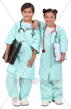 Two Children Dressed As Doctors Stock Photo