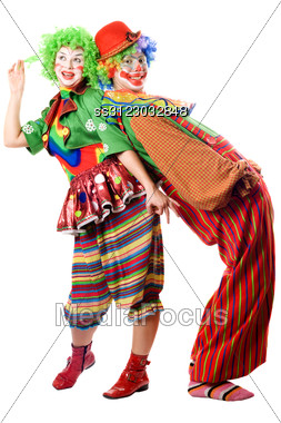 Two Clowns Are Back To Back. Stock Photo