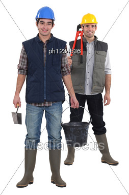 Two Constructions Workers Stood Together Stock Photo