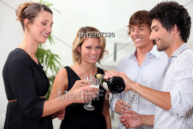 Two Couple Enjoying A Successful Year Stock Photo