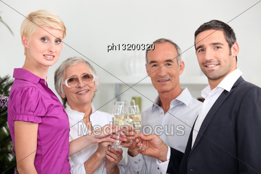 Two Couples Toasting With Champagne Stock Photo